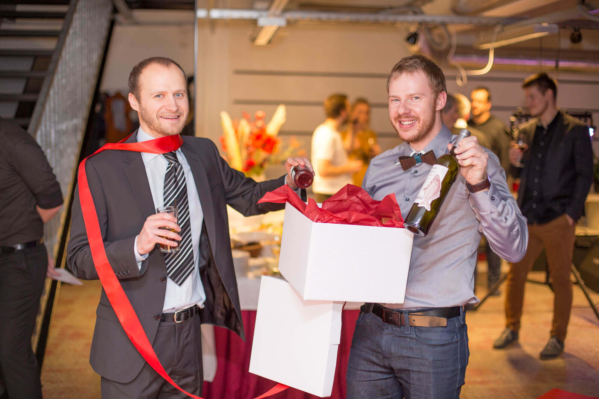 The company executives, Karel and Arni, are opening a gift.